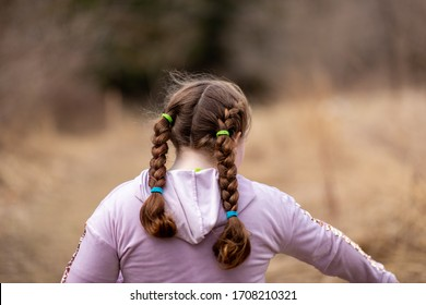 Girl with pony tails walking in nature