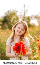 Girl in a poppy field.Sunset.Summer