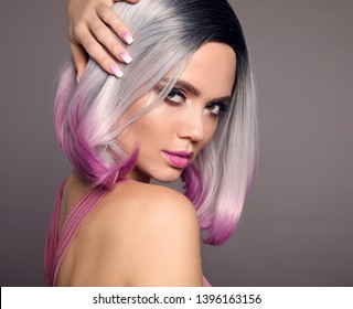 Girl Portrait of bob short hairstyle. Beautiful hair coloring woman. Trendy purple haircut. Blond model with short shiny haircuts isolated on grey Background. Makeup. Beauty Salon.