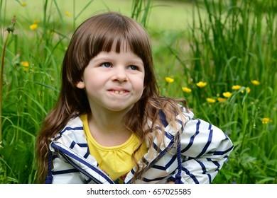 Girl portrait in green grass