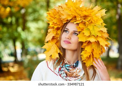 girl portrait with yellow leaves on head