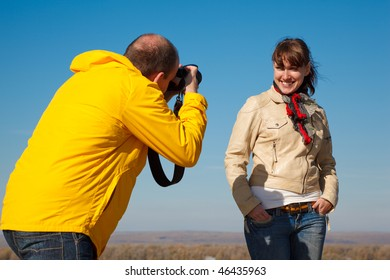 Girl poses for photographer, photo session on nature. Hobby which unites people.