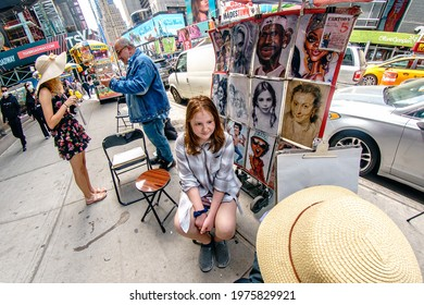 Girl poses for street artist on Times Square, great caricature for a fraction of the price, New York City, Manhattan, New York, United States, 5.15.2021