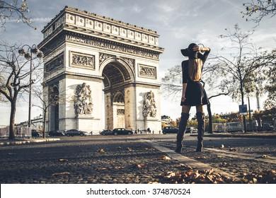 A girl posing in front of Arc de Triomphe, Paris