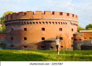 Girl posing near ancient fort