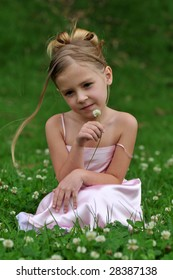 A girl is posing on the grass