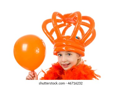 Girl is posing in orange outfit: ready for Dutch soccer game or Queensday, with crown and balloon over white background