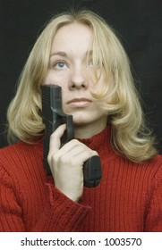 a girl posing with the pistol (image contains some noise)