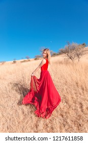 Girl posing in a red skirt in yellow fields Nogales, Sonora, Mexico