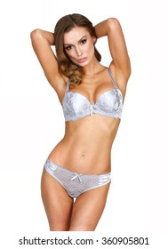 Girl posing in underwear on a white background