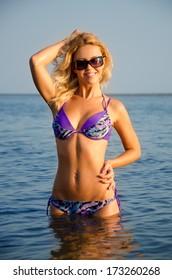 Girl posing in the water.