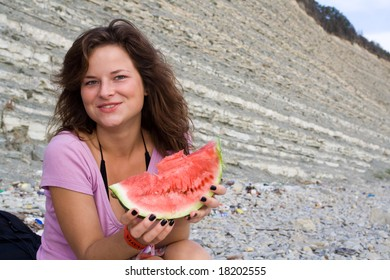 Girl posing with watermelon