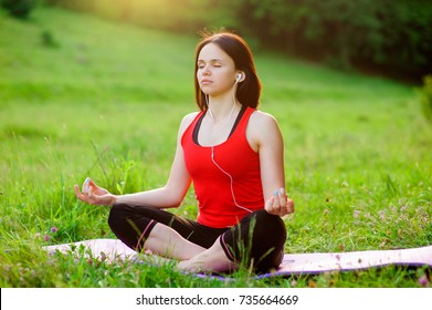 Girl posing yoga outside in the forest in the morning