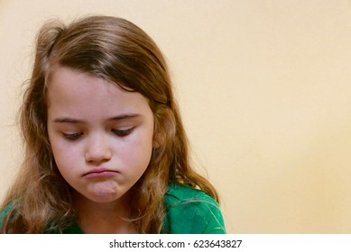 Girl with a pouting, sad face