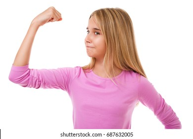 Girl power concept -  young teen girl showing her muscular arm for feminine and independent strength,studio shot