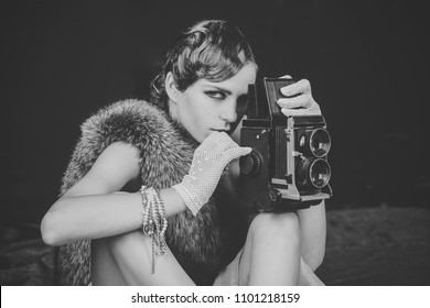 Girl Powered. Issues face girls. Woman with retro hair, makeup and old camera. Pin up pretty fashion model photographer. Girl with vintage photo camera. beauty, retro look, pinup fashion. media and