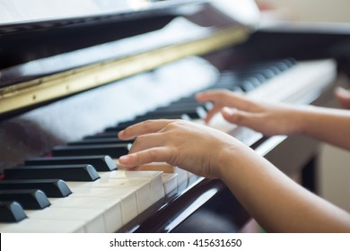 girl practices a piano lesson