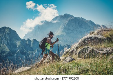 A girl practices trekking with an antivirus mask