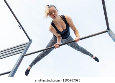 A girl practicing calisthenic exercises and tricks.