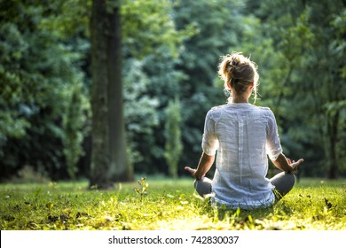 Girl practicing joga in forest