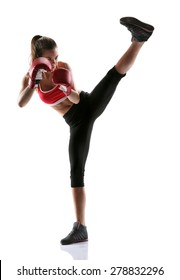 Girl practicing tae-bo exercises, kicking forward with legs. Photo of sporty girl isolated on white background. Strength and motivation. Full length.