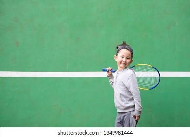 Girl practicing tennis