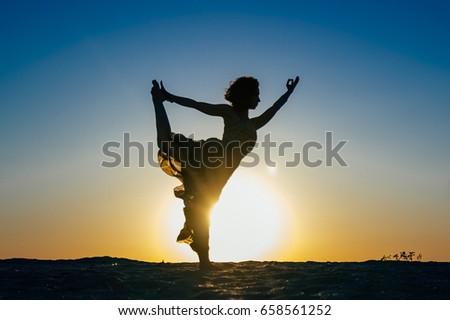 1756cda647 Girl Practicing Yoga Dress On Beach Stock Photo (Edit Now) 658561252 ...