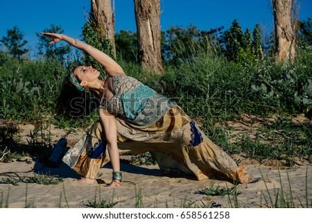 ac8ac4634a Girl Practicing Yoga Dress On Beach Stock Photo (Edit Now) 658561258 ...