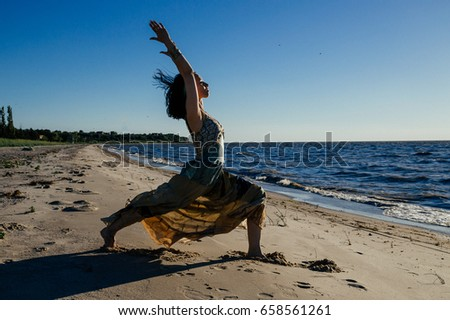 3ee1e5dd69 Girl Practicing Yoga Dress On Beach Stock Photo (Edit Now) 658561261 ...