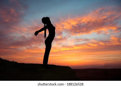 Girl practicing yoga at sunrise, outdoor sun