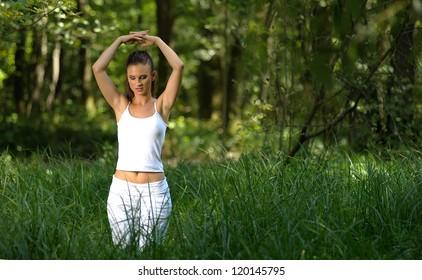 girl practising yoga in park