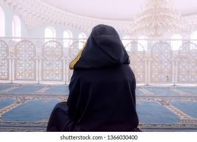 Girl praying in arab mosque