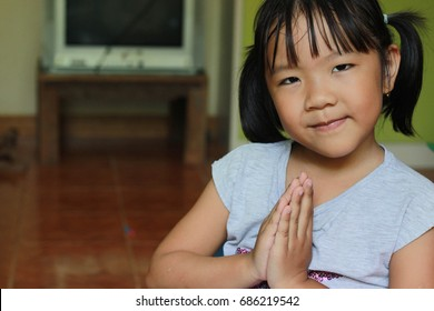 Girl praying in the morning.asian girl hand praying,Hands folded in prayer concept for faith,spirituality and religion.