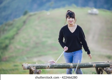 Girl prepare for selfie with mountainous scenery background.