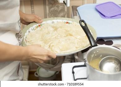 "girl prepares Kazakh national food ""Beshbarmak"""