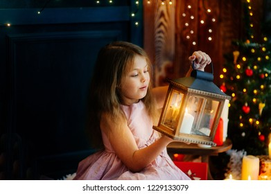 The girl is preparing for the new year and Christmas