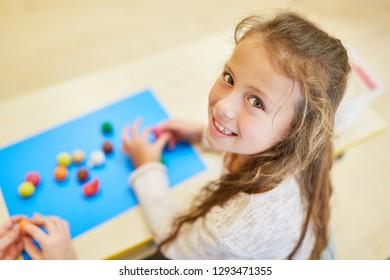 Girl as preschooler or freshmen at a preschool game