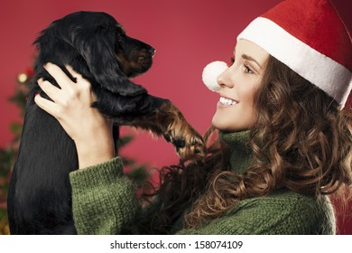 girl presented with a puppy