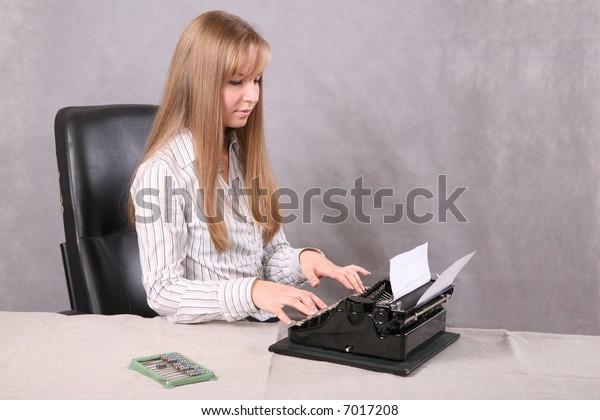 girl printing on the typewriter
