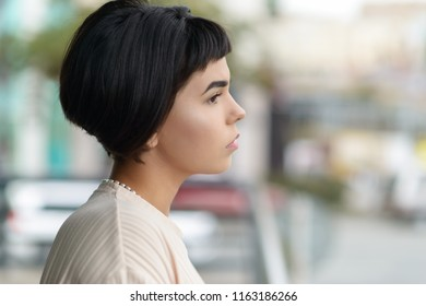 Girl in profile. Portrait of attractive young woman.