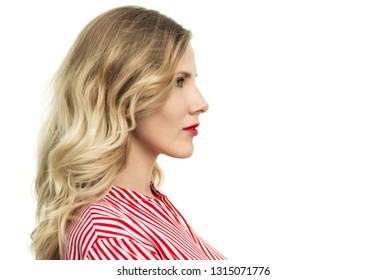 Girl in profile. Portrait of a beautiful young woman on light background.