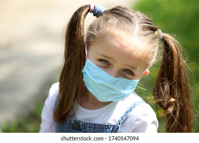 Girl with protective mask in park