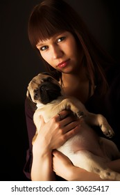 Girl and pug, studio shot