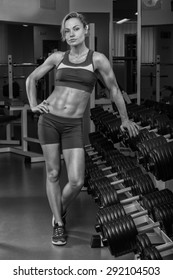 Girl pumps the major muscle groups in the gym. Strength training. Female fitness. Strong girl.