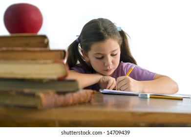 girl pupil sitting by the table with globe and red apple on a pile of books, Isolated on white