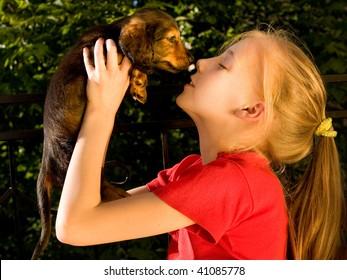 girl and  puppy dachshund
