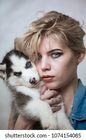 Girl with puppy husky