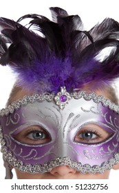 A girl in a purple mardi gras mask on a white background