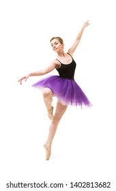 Girl in purple tutu and black leotard dance ballet. Studio shot on white background , isolated images.