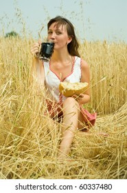 Girl  with quass and bread  at wheat field